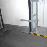 Door stopper on plateau with railings in holding position